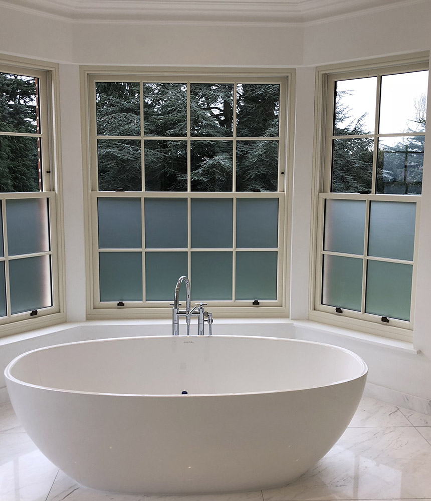 Privacy window film installation in bathroom setting